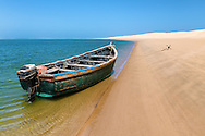 Fishing boat at the beach of Lagoon Khenifiss (Lac Naila), Atlantic coast, Morocco.