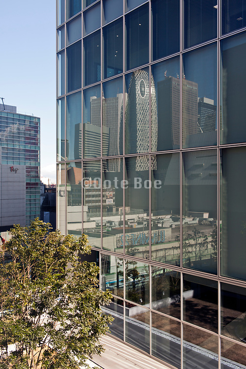 Shinjuku Tokyo the Mode Gakuen Cocoon tower and other office buildings refliecting in glass wall window high rise