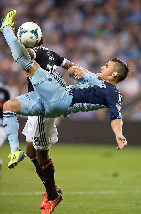 Sporting KC forward Dom Dwyer (14) made a bicycle kick behind Philadelphia Union defender Raymon Gaddis (28) in the second half during MLS action on September 27, 2013 at Sporting Park in Kansas City, Kan. Philadelphia won 1-0.