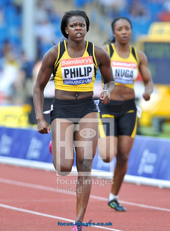 Picture by Alan Stanford/Focus Images Ltd +44 7915 056117<br /> 12/07/2013<br /> Asha Philip wins the 100m final  during day two of Sainsbury's British Championship at Alexander Stadium, Birmingham.