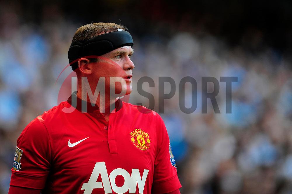 Manchester United's Wayne Rooney - Photo mandatory by-line: Dougie Allward/JMP - Tel: Mobile: 07966 386802 22/09/2013 - SPORT - FOOTBALL - City of Manchester Stadium - Manchester - Manchester City V Manchester United - Barclays Premier League
