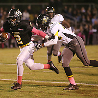 Lauren Wood | Buy at photos.djournal.com<br /> Pontotoc's Immanuel Vance pushes past Itawamba's Krayshawn Middlebrook during Friday night's game at Pontotoc.