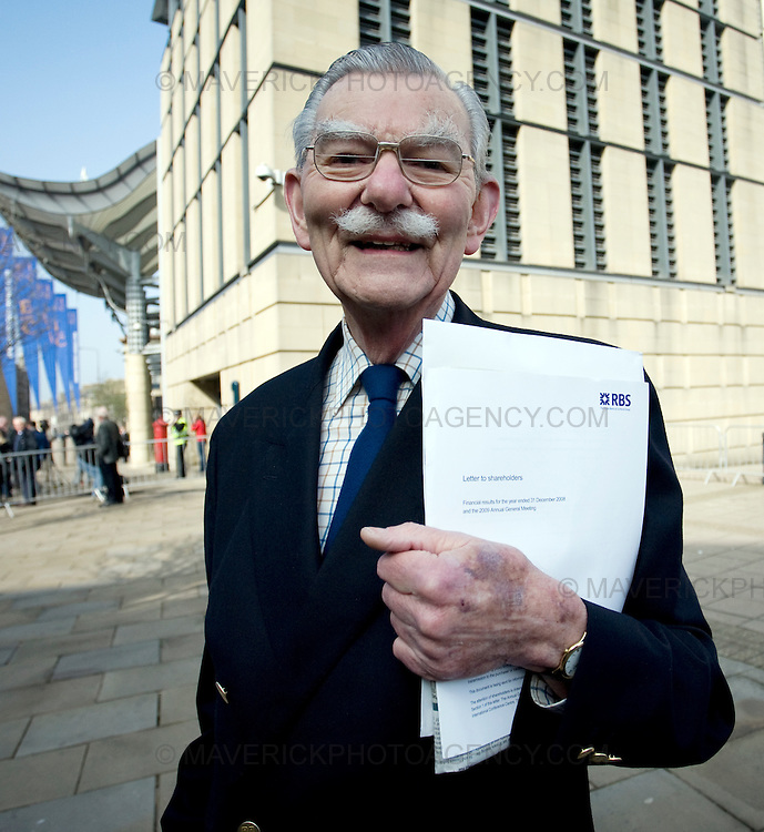 A shareholder arrives at the Edinburgh International Conference Centre in Edinburgh where they will come face to face with the Royal Bank of Scotland directors at todays AGM..03/4/09.Michael Hughes/Maverick.Tel. 07789681770