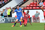 AFC Wimbledon defender Sean Kelly (22) tussles with Walsall FC defender James O'Connor (4) jump during the EFL Sky Bet League 1 match between Walsall and AFC Wimbledon at the Banks's Stadium, Walsall, England on 6 August 2016. Photo by Stuart Butcher.