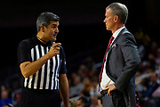 Southern California Trojans head coach Andy Enfield talks with the referee during the first half of an NCAA basketball game against the South Dakota State Jackrabbits, Tuesday, Nov. 12, 2019, in Los Angeles. USC defeated South Dakota State 84-66. (Brandon Sloter/Image of Sport)