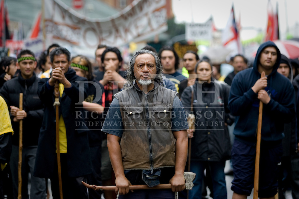 Malcolm Kerehoma carrying a Tuku leads thousands of marches form all over Auckland as they make their way up Queen Street during a hikoi against the proposed Auckland Supercity. May2009.<br />
