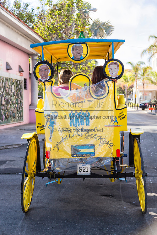 Decorated horse carriage with tourists at Prince George Wharf, Nassau, Bahamas, Caribbean