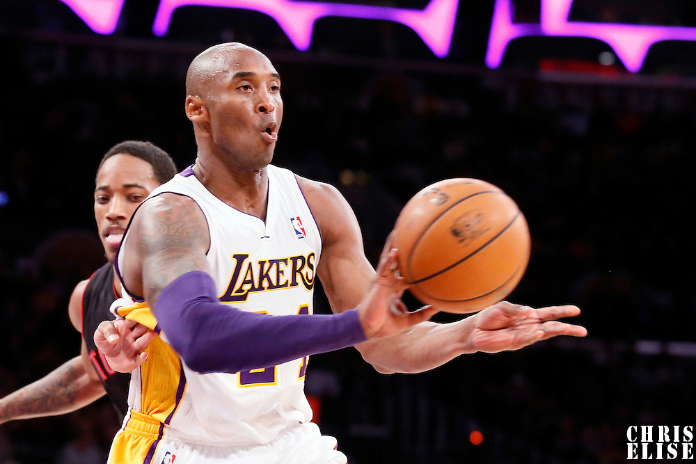 08 December 2013: Los Angeles Lakers shooting guard Kobe Bryant (24) passes the ball during the Toronto Raptors 106-94 victory over the Los Angeles Lakers at the Staples Center, Los Angeles, California, USA.