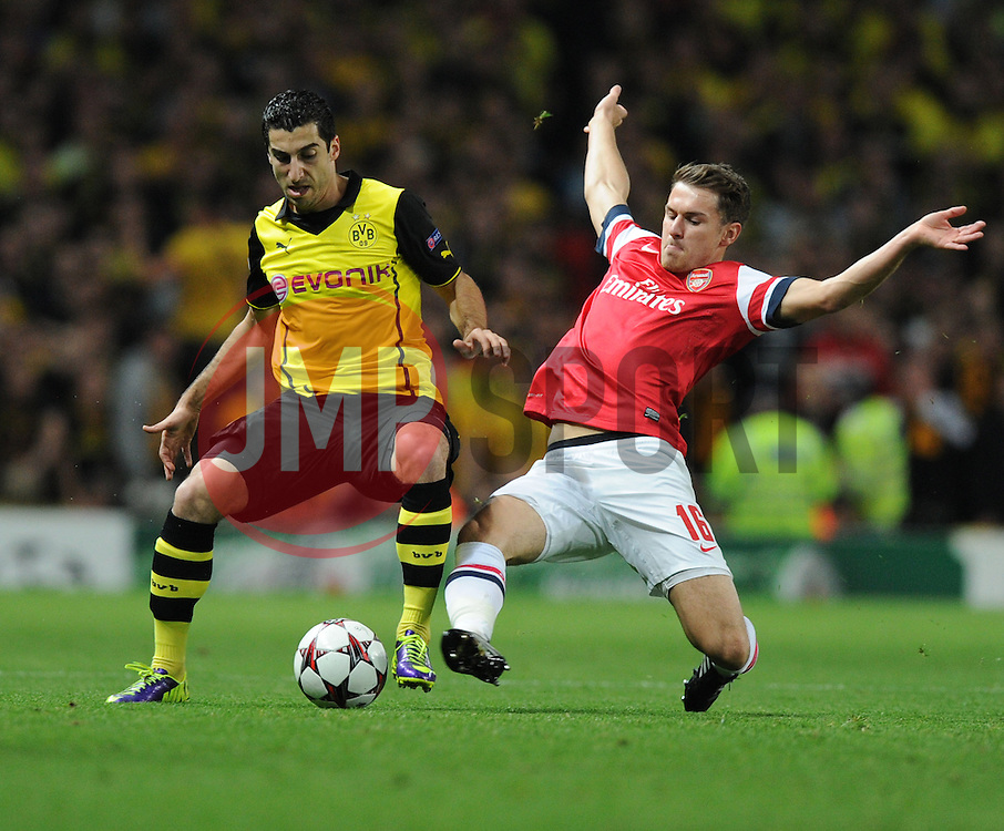 Arsenal's Aaron Ramsey tackles Borrusia Dortmund's Henrik Mkhitaryan- Photo mandatory by-line: Alex James/JMP - Tel: Mobile: 07966 386802 22/10/2013 - SPORT - FOOTBALL - Emirates Stadium - London - Arsenal v Borussia Dortmund - CHAMPIONS LEAGUE - GROUP F
