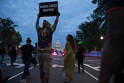 Protestors march down Constitution Ave. following a  rally against police brutality held in Lafayette Park north of the White House on Thursday July 7th, 2016. The rally escalated into a march from the White House to the U.S. Capitol.
