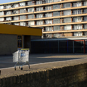"Nederland Utrecht 31 januari 2009 20090131 Foto: David Rozing ..Serie vogelaarwijk Kanaleneiland .Reportage documentary on deprived area / projects "" Kanaleneiland "" This area is on a list with projects which need help of the government because of degradation in the area etc..Leeg winkelwagentje achtergelaten op schoolplein, op de achtergrond flat .Empty shopping cart left behind on school square, in the background appartments,  antisocial  stilleven, still, stillshot, still life.project, suburb, suburbian, problem. Neighboorhood, neighboorhoods, district, city, problems, multicultural, daily life.Foto: David Rozing"