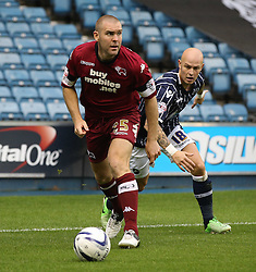 Derby County's Jake Buxton vies for possession with Millwall's Richard Chaplow  - Photo mandatory by-line: Robin White/JMP - Tel: Mobile: 07966 386802 14/09/2013 - SPORT - FOOTBALL -  The Den - London - Millwall V Derby County - Sky Bet League Championship