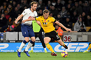 Wolverhampton Wanderers defender Ryan Bennett (5) clears from \Harry Kane of Tottenham Hotspur during the Premier League match between Wolverhampton Wanderers and Tottenham Hotspur at Molineux, Wolverhampton, England on 3 November 2018.