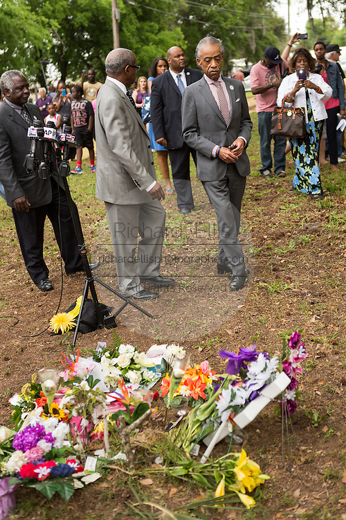 Rev. Al Sharpton arrives a peace vigil at the spot where unarmed motorist Walter Scott was gunned down by police April 12, 2015 in North Charleston, South Carolina. About 100 people showed up for the brief vigil following a healing service at Charity Mission Baptist Church.