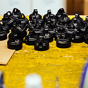 Completed mountain bike shock caps heading towards the assembly plant right after final inspection.