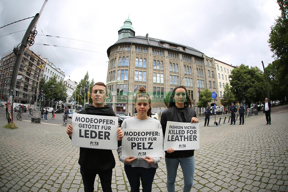 July 4, 2017 - Berlin, Berlin-Mitte, Germany - Bikini-clad PETA supporters demonstrate with big leather bags at the beginning of the Fashion Week in front of the Jahndorf-Kaufhaus in Berlin Mitte. Sexy action against agony of the animals (Credit Image: © Simone Kuhlmey/Pacific Press via ZUMA Wire)