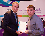 Sean Kyne TD Minister of State for Community Affairs, Natural Resources and Digital Development, presenting certification in Employer Based Training  to David Heavy QQI level 4 in IT skills  IT Skills , workplace safety and Work Experience. Photo:Andrew Downes, xposure .