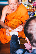 Monk blessing David Thompson and Tom Parker-Bowles at the Royal Place, Bangkok