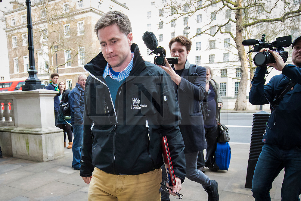 © Licensed to London News Pictures. 10/03/2018. London, UK. An official from Public Health England arrives at the Cabinet Office for an emergency Cobra meeting to discuss the suspected nerve agent attack on former Russian double agent Sergei Skripal, 66, and his daughter Yulia, 33, in Salisbury. Photo credit: Rob Pinney/LNP