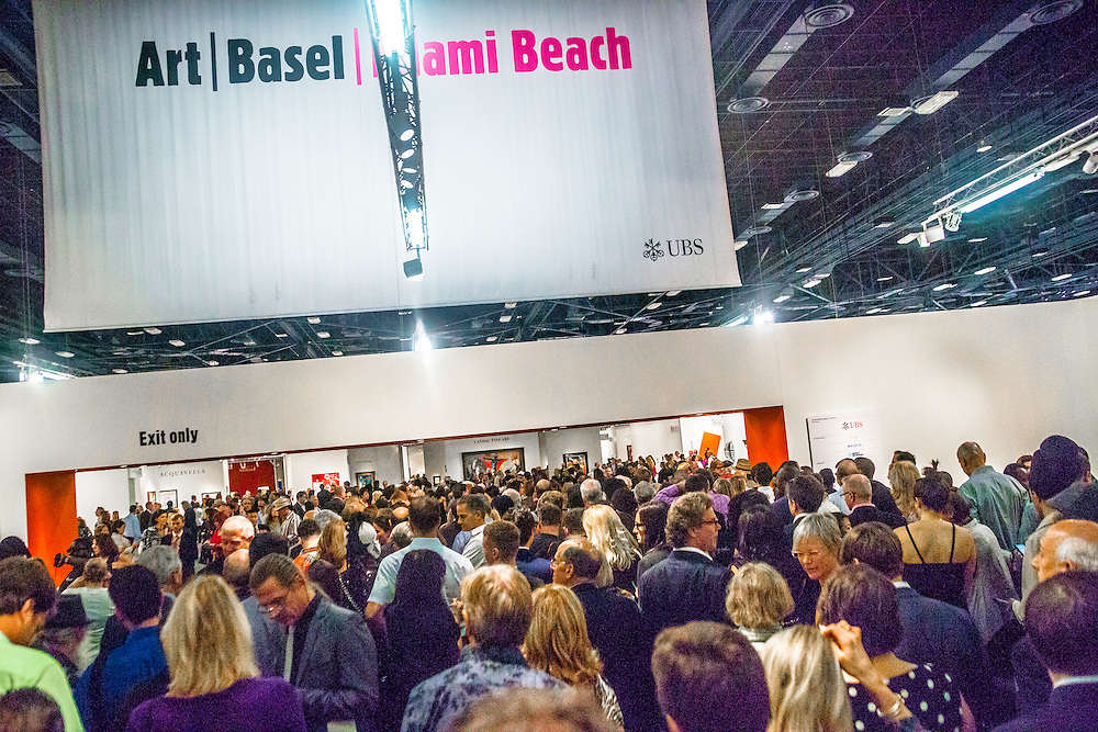 Crowd gathers for the by-invitation-only opening night of Art Basel Miami Beach 2012