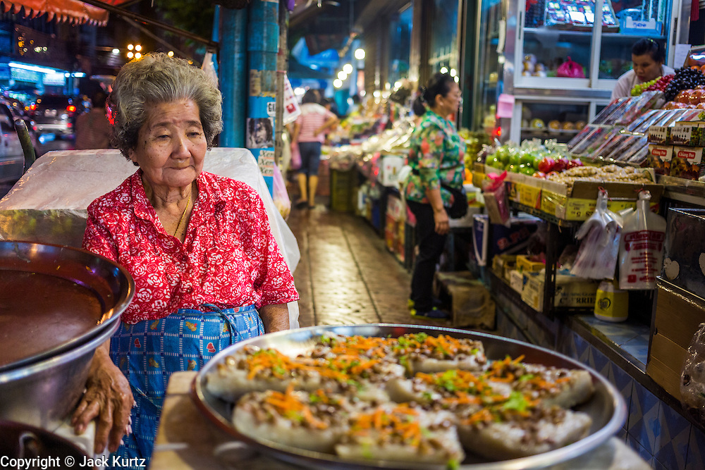 18 SEPTEMBER 2013 - BANGKOK, THAILAND: A pastry vendor in the Chinatown section of Bangkok. Thailand in general, and Bangkok in particular, has a vibrant tradition of street food and eating on the run. In recent years, Bangkok's street food has become something of an international landmark and is being written about in glossy travel magazines and in the pages of the New York Times.      PHOTO BY JACK KURTZ