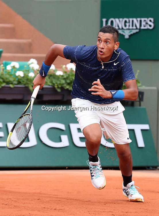 French Open 2014, Roland Garros,Paris,ITF Grand Slam Tennis Tournament,<br /> Nick Kyrgios (AUS) sprinted nach vorne,Aktion,Einzelbild,<br /> Ganzkoerper,Hochformat,