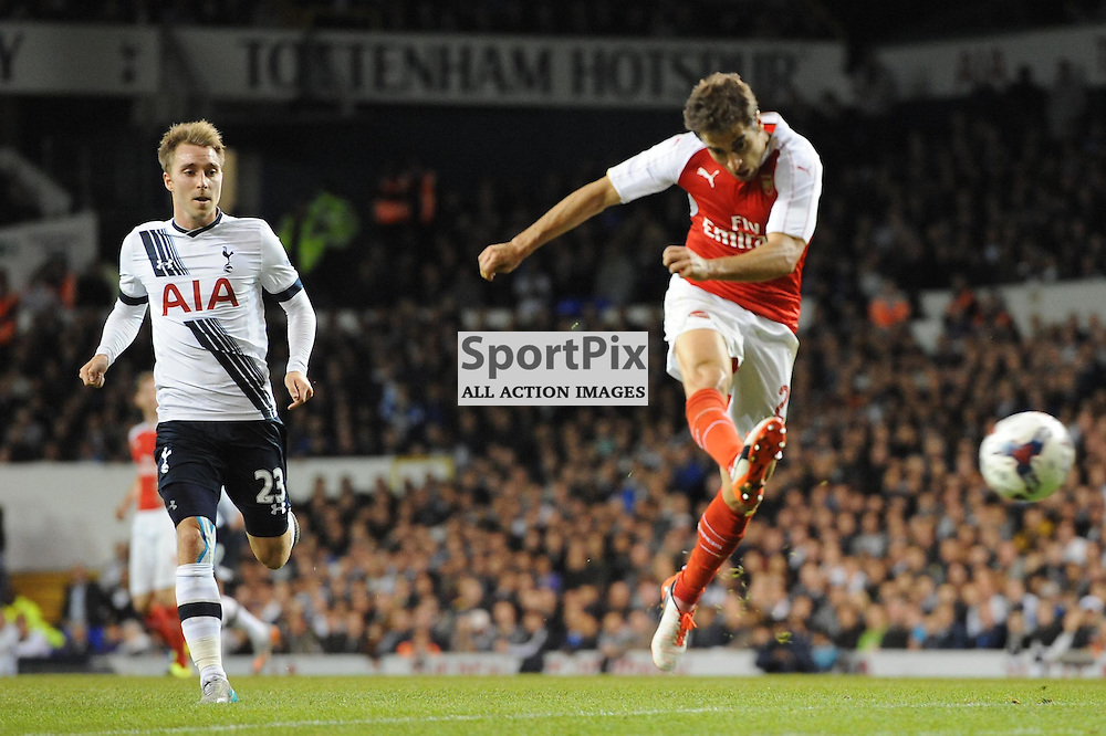 Arsenals Matthieu Flamini restores Arsenals lead during the Capital One Cup third round tie between Tottenham and Arsenal on 23rd September 2015