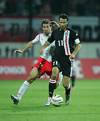 WARSAW, POLAND - WEDNESDAY, SEPTEMBER 7th, 2005: Wales' Ryan Giggs and Poland's Radoslaw Soblewski during the World Cup Group Six Qualifying match at the Legia Stadium. (Pic by David Rawcliffe/Propaganda)