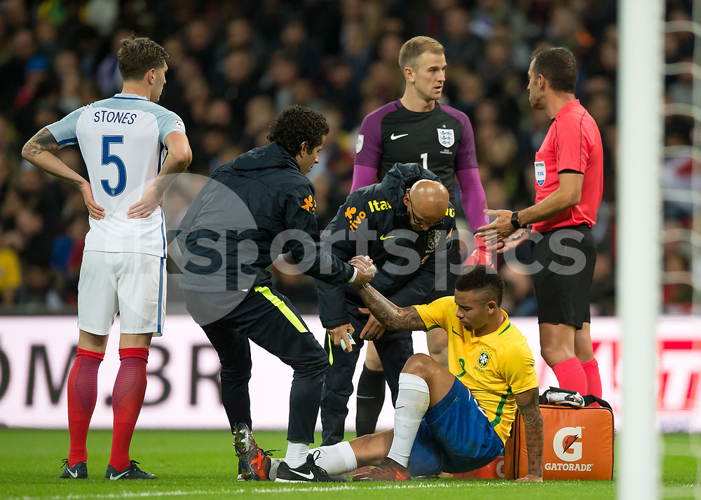 Gabriel Jesus of Brazil is helped to his feet during the International Friendly match between England and Brazil at Wembley Stadium, London, England on 14 November 2017. Photo by Vince Mignott.
