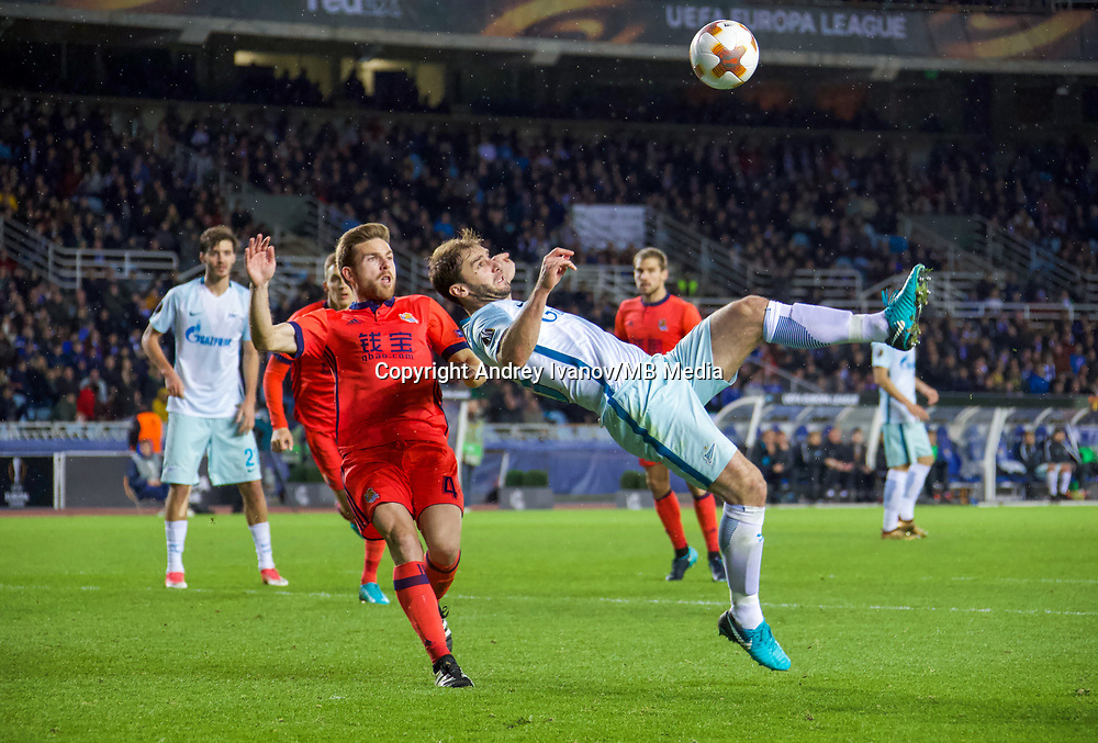SAN SEBASTIAN, SPAIN - DECEMBER 07, 2017. 2017-18 UEFA Europa League Group L Round 6 football match: Real Sociedad (San Sebastian) - Zenit (St Petersburg) 1 - 3. Real Sociedad's Asier Illarramendi Andoneg (L) and Zenit St Petersburg's Branislav Ivanovich (R).