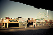 A passerby on Coney Island's baordwalk, Brooklyn, New York, 2010.