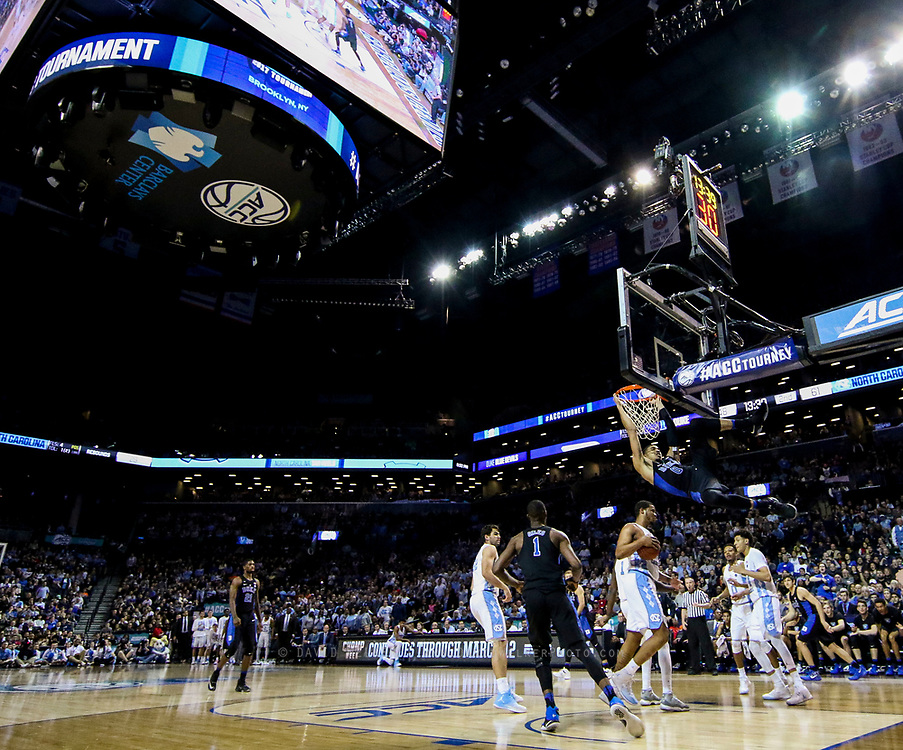 Duke forward Jayson Tatum (0) hangs from the rim after dunking the ball during the semifinals of the 2017 New York Life ACC Tournament at the Barclays Center in Brooklyn, N.Y., Friday, March 10, 2017. (Photo by David Welker, theACC.com)