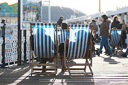© Licensed to London News Pictures. 28/01/2016. Brighton, UK. Members of the public relax in the sun on Brighton Pier. Today January 28th 2016. Photo credit: Hugo Michiels/LNP