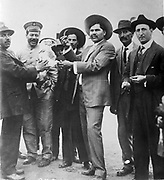 Francisco 'Pancho' Villa, born Doroteo Arango Arambula (1878-1923), Mexican Revolutionary General. Villa, second left in military cap, with Raul Madero, c1923, Villa was ambushed and assassinated on 20 July 1923.