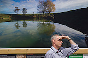 Marking the centenary of the the beginning of the First World War (WW1) in 1914, visitors to the Heritage Lottery funded, Fields of Battle Lands of Peace Street Gallery in St James's Park, central London, an outdoor exhibition of photography by Michael St Maur Sheil's 7-year project recording the landscapes of battefields along the Western front. Aerial views of Beaumont Hamel trenches include scarring in the land by shell holes. Across the world, remembrance ceremonies for this historic conflict that affected world nations.