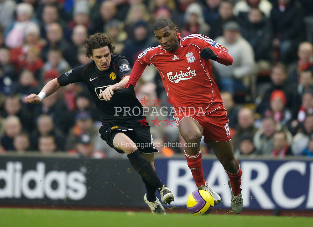 LIVERPOOL, ENGLAND - Sunday, December 16, 2007: Liverpool's Ryan Babel and Manchester United's Owen Hargreaves during the Premiership match at Anfield. (Photo by David Rawcliffe/Propaganda)