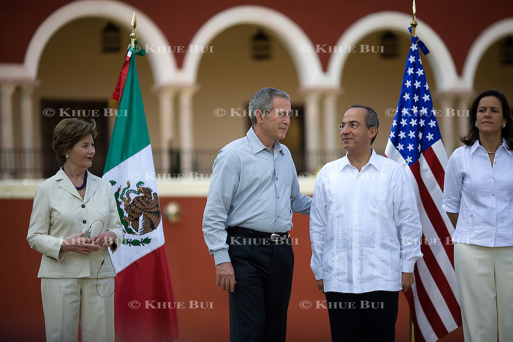 President Bush and President of Mexico Felipe Calderon attend an arrival ceremony Tuesday, March 13, 2007.  Also attending are US First Lady Laura Bush and Marguerita Zavala...Photo by Khue Bui