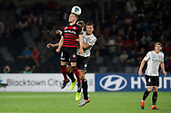 SYDNEY, AUSTRALIA - NOVEMBER 22: Western Sydney Wanderers forward Nicolai Muller (9) heads the ball during the round 7 A-League soccer match between Western Sydney Wanderers FC and Melbourne City FC on November 22, 2019 at Bankwest Stadium in Sydney, Australia. (Photo by Speed Media/Icon Sportswire)