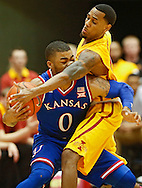 Kansas Jayhawks guard Frank Mason III (0) is closely guarded by Iowa State Cyclones guard Monte Morris (11) during the first half of their NCAA basketball game at Hilton Coliseum in Ames on Monday, Jan. 25, 2016.