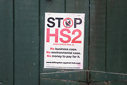 Harefield, UK. 13 January, 2020. A Stop HS2 poster on a garage door.