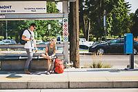 Rob Aseltine and Kelly Halpin wait for the streetcar in the Sugar House neighborhood of Salt Lake City, Utah.
