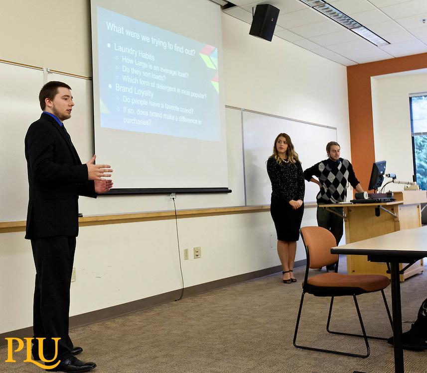 Susan Harmon's Business 467 students presenting projects in Morken Centerat PLU on Thursday, Dec. 11, 2014. (Photo/John Froschauer)