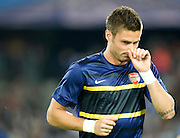 Olivier Giroud of Arsenal picks his nose before the Champions League group match between Montpellier and Arsenal at the Stade la Mosson, Montpellier, France, 18th September 2012. Eoin Mundow/Cleva Media