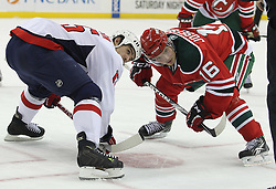 Mar 18; Newark, NJ, USA; Washington Capitals right wing Boyd Gordon (15) and New Jersey Devils center Jacob Josefson (16) get ready to faceoff during the second period at the Prudential Center.