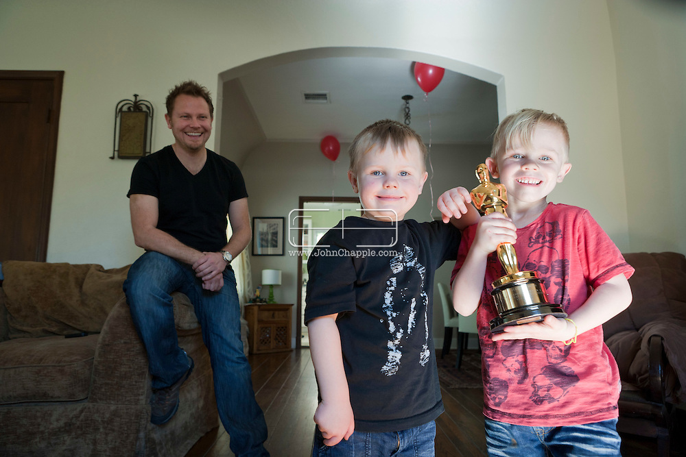 11th February 2011. Glendale, California.  Dubliner Richie Baneham, won the Oscar for Best Visual Effects in 2010 for his work on the groundbreaking 3D science fiction film Avatar. Richie's sons, 3-year-old Nathan (black T-shirt) and  5-year-old Daniel (red T shirt)  hold their Dad's Oscar..Photo © John Chapple / www.johnchapple.com..
