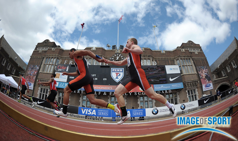 Apr 27, 2012; Philadelphia, PA, USA; General view of a handoff between Adam Lewis (right) and Anthony Bullaro of Pennsbury in a boys large school 4 x 100m relay heat in the 118th Penn Relays at Franklin Field.