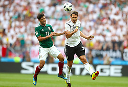 Mexico's Carlos Vela (left) and Germany's Mats Hummels battle for the ball