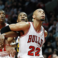 10 March 2012: Chicago Bulls forward Taj Gibson (22) vies for the rebound with Utah Jazz forward Derrick Favors (15) during the Chicago Bulls 111-97 victory over the Utah Jazz at the United Center, Chicago, Illinois, USA.