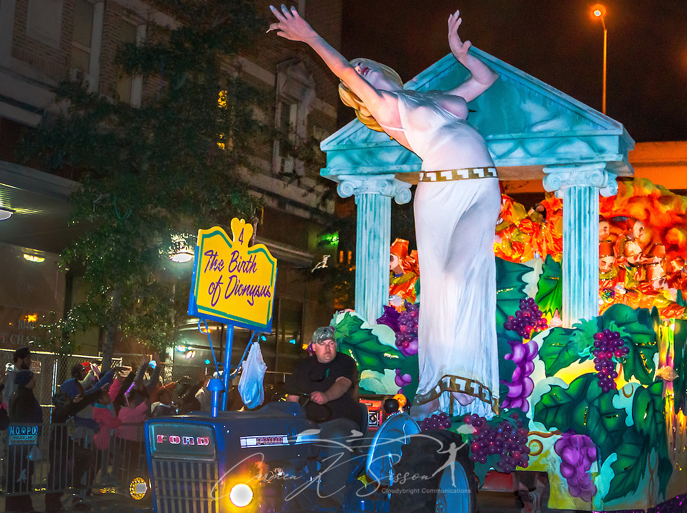"""Members of the Krewe of Hermes ride the """"Birth of Dionysus"""" float down St. Charles Avenue at Lee Circle, Feb. 28, 2014, in New Orleans, Louisiana. Dionysus was the Greek god of wine, ritual madness, religious ecstasy, and theater. (Photo by Carmen K. Sisson/Cloudybright)"""