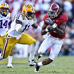 November 6, 2010; Baton Rouge, LA, USA; Alabama Crimson Tide wide receiver Julio Jones (8) runs from LSU Tigers linebacker Kelvin Sheppard (11) during the second half at Tiger Stadium. LSU defeated Alabama 24-21.  Mandatory Credit: Derick E. Hingle